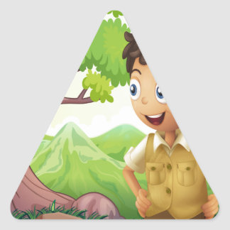 A young boyscout in the forest triangle sticker