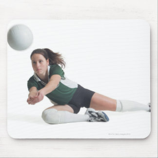 a young caucasian female volleyball player in a mouse mat