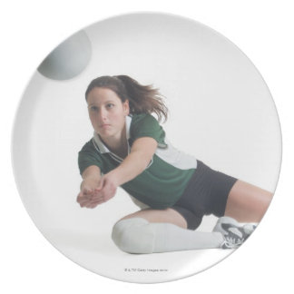 a young caucasian female volleyball player in a plate