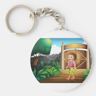 A young girl at the gated yard basic round button keychain