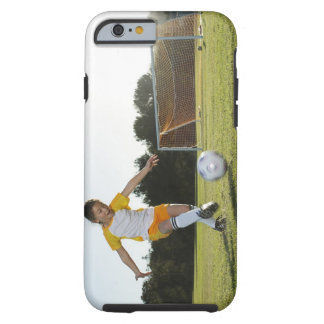 A young girl playing soccer on a soccer field in tough iPhone 6 case