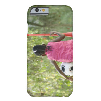 A young girl sits on a bench, holding a Vuvuzela Barely There iPhone 6 Case