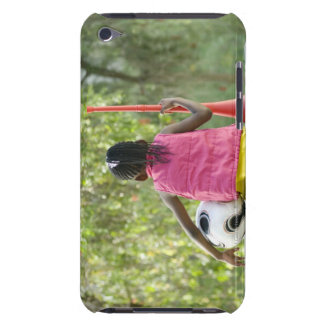 A young girl sits on a bench, holding a Vuvuzela Case-Mate iPod Touch Case