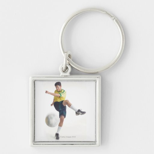 a young latin male wears a yellow soccer jersey key chains