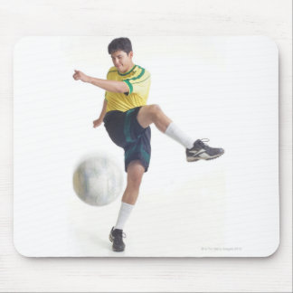 a young latin male wears a yellow soccer jersey mouse mat