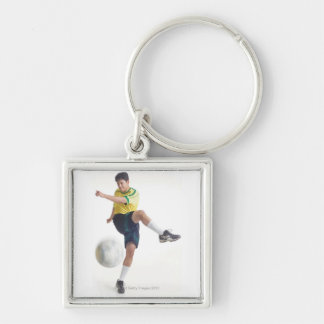 a young latin male wears a yellow soccer jersey Silver-Colored square key ring