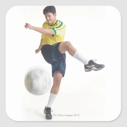 a young latin male wears a yellow soccer jersey stickers