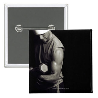 A young man lifts weights. 15 cm square badge