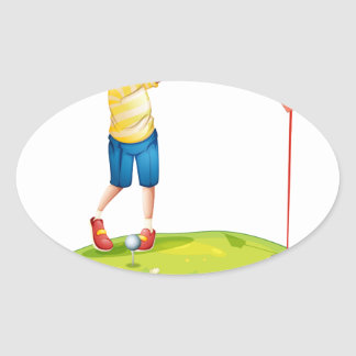 A young man playing golf oval sticker