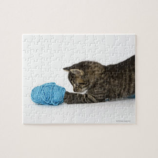 A young Tabby kitten playing with wool. Jigsaw Puzzle