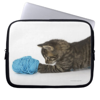 A young Tabby kitten playing with wool Laptop Sleeve