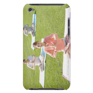 A young woman doing yoga barely there iPod case