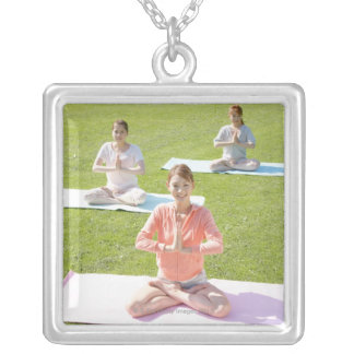 A young woman doing yoga silver plated necklace