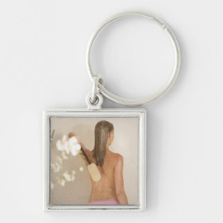 A young woman in a shower Silver-Colored square key ring
