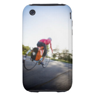 A young woman rides a bike around a park at iPhone 3 tough cases