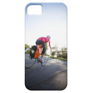 A young woman rides a bike around a park at iPhone 5 cover