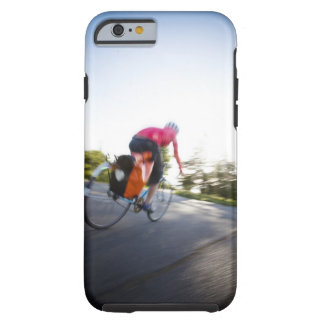 A young woman rides a bike around a park at tough iPhone 6 case