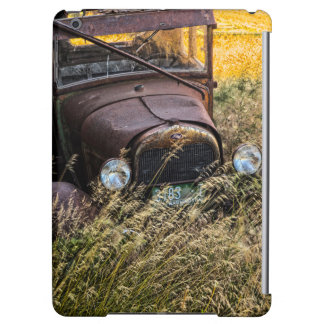 Abandoned old car in tall grass