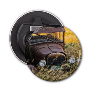 Abandoned old car in tall grass bottle opener