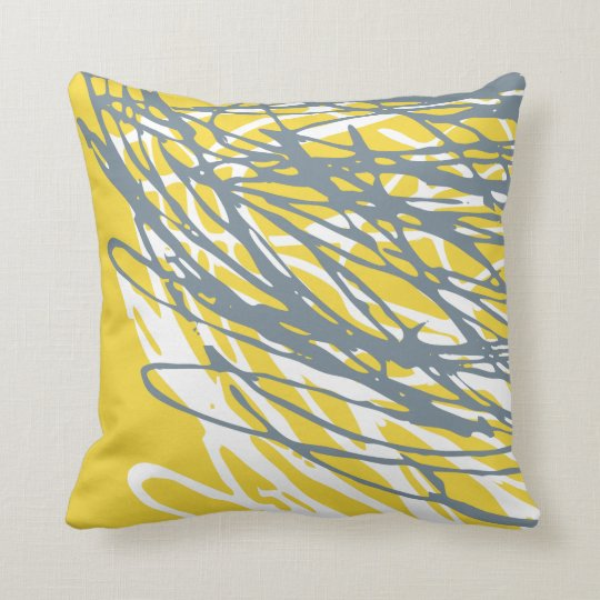 Abstract design in grey and yellow cushion