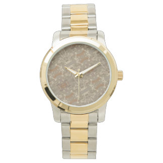 ABSTRACT GOLD WRIST WATCHES