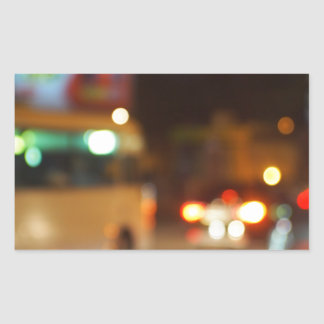 Abstract night scene with bus and headlights rectangular sticker