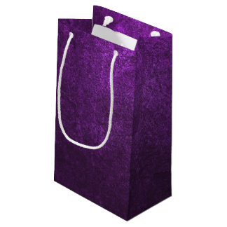Abstract Purple Background Or Paper With Bright Small Gift Bag