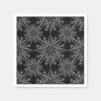Abstract tribal snowflake on black background. disposable napkins