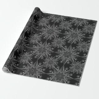 Abstract tribal snowflake on black background wrapping paper