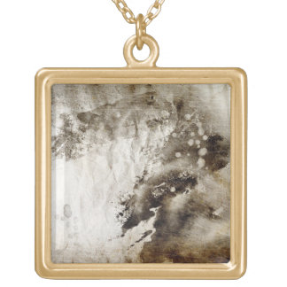 Abstract watercolor background on grunge paper gold plated necklace