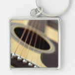 Acoustic guitar closeup photo Silver-Colored square key ring