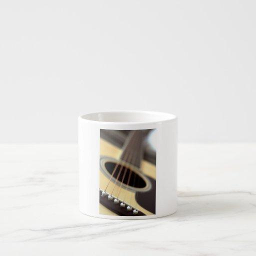 Acoustic guitar closeup photo espresso mugs