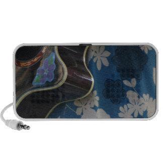 Acoustic Guitar Edge Against Blue Flower Dress Notebook Speaker