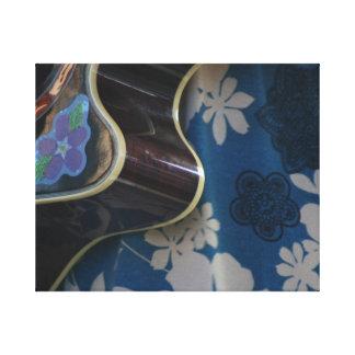 Acoustic Guitar Edge Against Blue Flower Dress Stretched Canvas Print