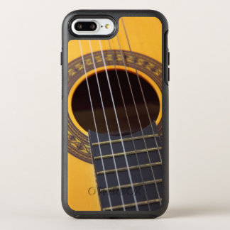 Acoustic Guitar with the six string going from one OtterBox Symmetry iPhone 8 Plus/7 Plus Case