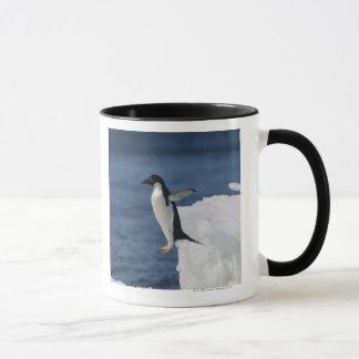 Adelie penguin leaping from iceberg mug