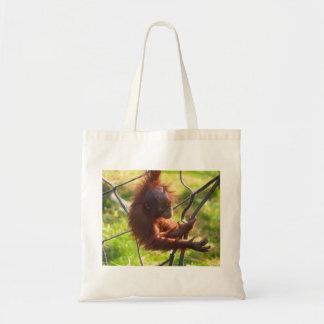 Adorable baby orangutan tote bag