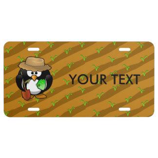 Adorable Cartoon Penguin Farmer on Field License Plate