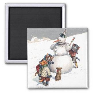 Adorable Cats Building a Snowman Magnet