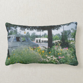 Adorable Retro Flowerbed with Car in Background Pillows