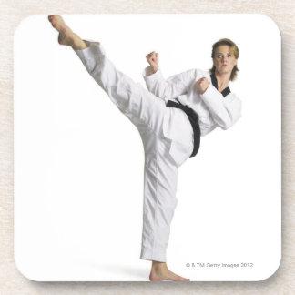 adult caucasian female martial arts expert in coaster