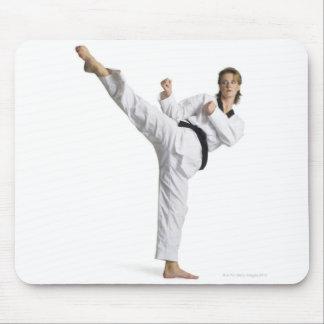 adult caucasian female martial arts expert in mouse mat