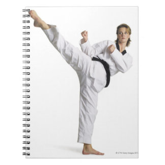 adult caucasian female martial arts expert in notebook