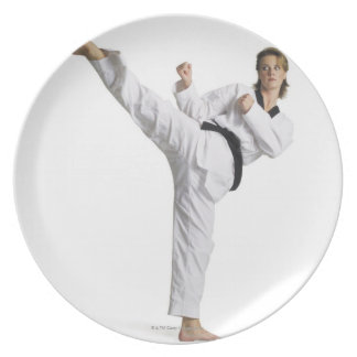 adult caucasian female martial arts expert in party plates
