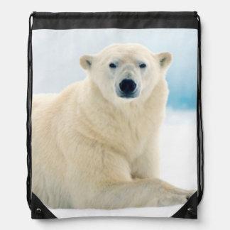 Adult polar bear large boar on the summer ice drawstring bag