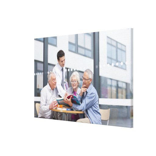 Adult students and teacher studying together in 2 canvas print
