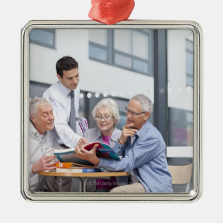 Adult students and teacher studying together in 2 christmas ornament