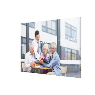 Adult students and teacher studying together in 2 stretched canvas print