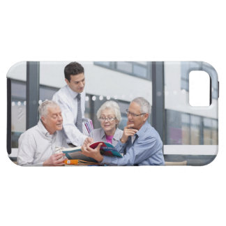 Adult students and teacher studying together in 2 tough iPhone 5 case