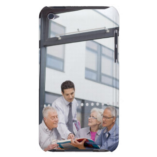 Adult students and teacher studying together in barely there iPod case